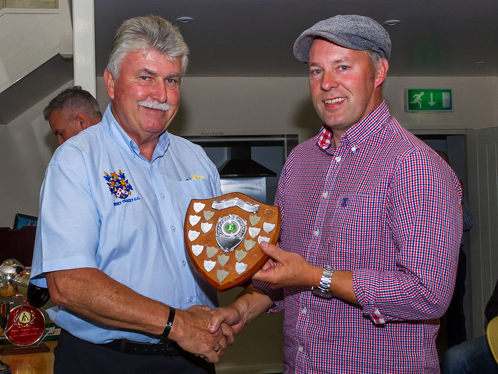 BIG HITTER: Paul Scott's rapid 146 not out against Shaldon was the top score made by a Bovey batter in 2019. David Woods (left) is pictured presenting him with the Highest Score Shield
