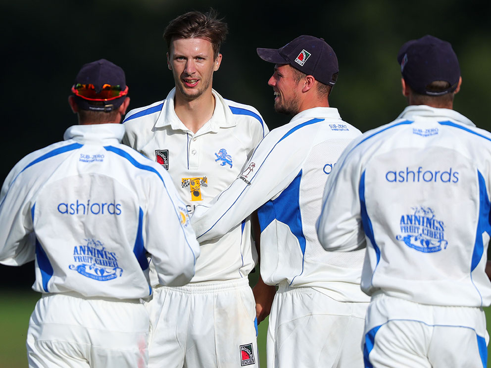 Devon's Hugo Whitlock is the centre of attention after taking a wicket in game against Wiltshire at Sandford in 2019<br>credit: www.ppauk.com
