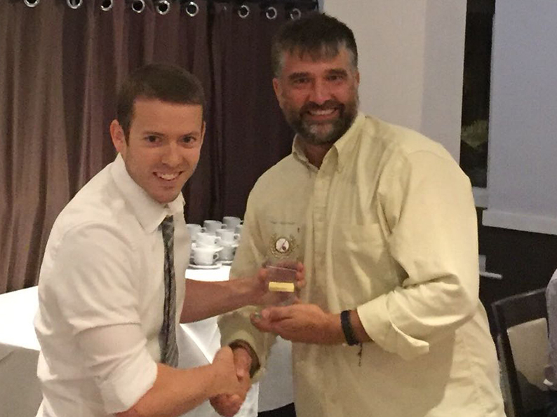 Chris Yeo hands over the 2nd XI all-rounder award to Marcus West