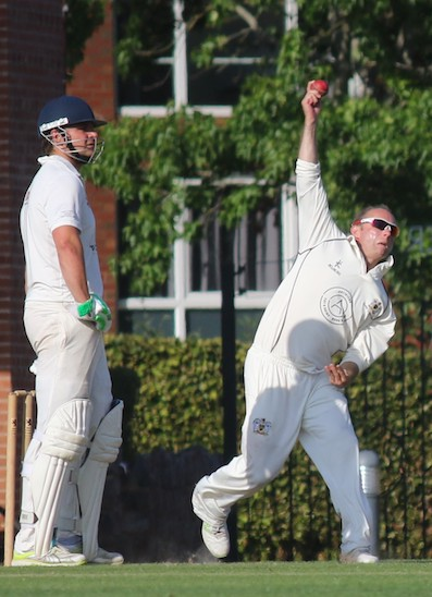 Exeter's Rob Holman on the way to his first five-wicket haul in the Premie Division. The non-striking batsman is Miles Lenygon
