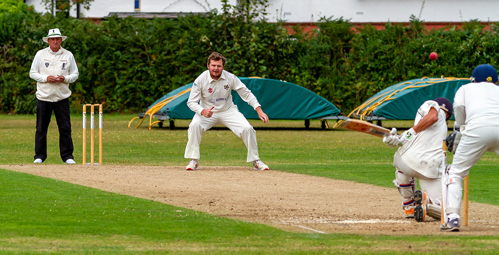 Bovey Tracey captain Toby Codd on his way to a four-wicket haul against Exeter | Photo: Mark Lockett